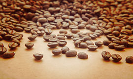 Beans of coffee on light brown paper instagram stile Royalty Free Stock Photos