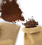 Beans and coffee powder with bag Royalty Free Stock Photo
