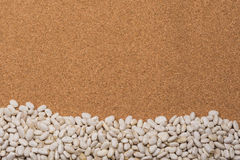 Beans on cork background Royalty Free Stock Photography