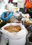 Beans Corn Brazil Nuts Peanuts. A collection of dried goods ready for sale at outdoor market, farmer's market Royalty Free Stock Photo
