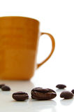 Beans and cup Royalty Free Stock Images