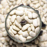 Beans in the cup. On blurred background Stock Photos