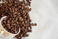 Beans and cup at textile Stock Images