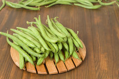 Beans on cutterboard Stock Image