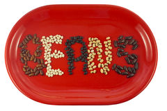 Beans of different kinds on the red dish, isolate Stock Images