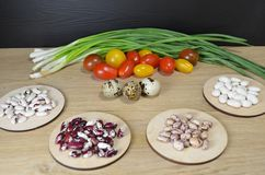 Beans of different varieties on the table royalty free stock image