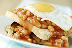Beans and egg on toast royalty free stock photography