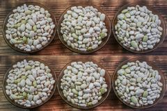 Beans in glass bowls stock image