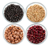 Beans in glass containers isolated on white stock images
