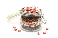 Beans in a glass jar on a white background Royalty Free Stock Photos