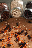 Beans and grain mix in glass jars on a wooden table. Closeup shot, selective focus, vertical royalty free stock image