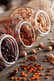 Beans and grain mix in open glass jars on a wooden table. Selective focus, closeup, vertical stock photography