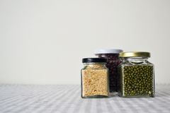 Beans & Grains in Square Glass Jar. Red bean, green bean & grains storing in a square glass jar royalty free stock photography