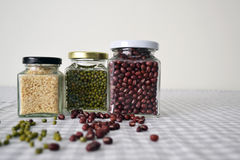 Beans & Grains in Square Glass Jar. Red bean, green bean & grains storing in a square glass jar Stock Images