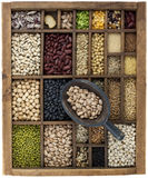 Beans and grains in vintage box with scoop Royalty Free Stock Image