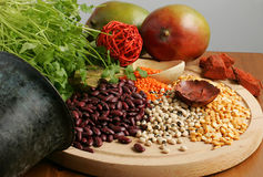 Beans greens and raw foods Stock Photography