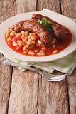 Beans with grilled sausage, traditional european homemade meal. Stock Photos