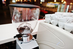 Beans in the grinder in coffee bar Stock Images