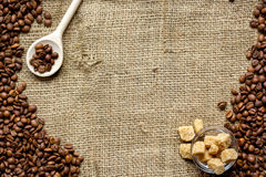 Beans, ground coffee and sugar cane on linen cloth Stock Photos