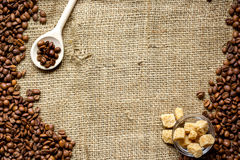 Beans, ground coffee and sugar cane on linen cloth Stock Photography