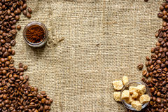 Beans, ground coffee and sugar cane on linen cloth Royalty Free Stock Photography