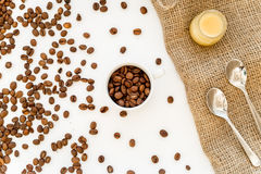 Beans, ground coffee and sugar cane on linen cloth Stock Image