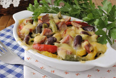 Beans with ham and vegetables, baked with cheese Stock Photos
