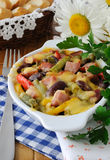 Beans with ham and vegetables, baked with cheese Royalty Free Stock Photography