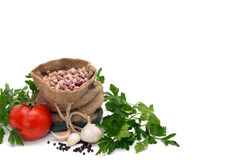 Free Beans In A Bag Surrounded By Tomatoe, Garlic, Pepper And Parsley Isolated On White Royalty Free Stock Image - 37979066