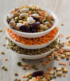 Beans and lentil on a wooden table Stock Images