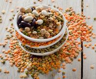 Beans and lentil on a wooden table Royalty Free Stock Image