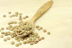Beans lentils in a wooden spoon Stock Photo