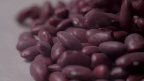 Beans lie in a pile and crumble. Slow motion. Food video