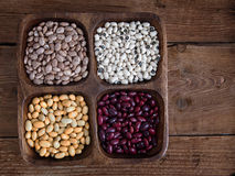 Beans mix in wooden tray Royalty Free Stock Images