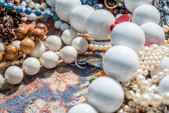 Beans necklaceses in the flea market. In Berlin, Germany Stock Photo