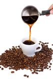 Beans and outpouring coffee Royalty Free Stock Photography