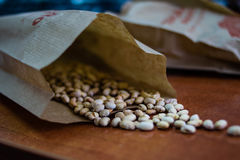 Beans in paper bag. In market Royalty Free Stock Photos