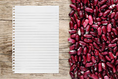 Beans and paper for recipe Royalty Free Stock Image