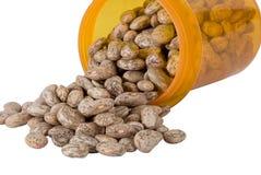 Beans in a pill bottle Stock Photos