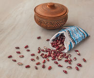 Beans and pot on the table Royalty Free Stock Photo