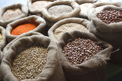 Beans, rice, lentils, oats, wheat, and barley in jute sack Royalty Free Stock Image