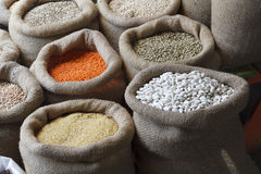 Beans, rice, lentils, oats, wheat, and barley in jute sack Royalty Free Stock Photos