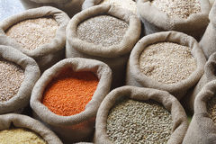 Beans, rice, lentils, oats, wheat, and barley in jute sack Royalty Free Stock Images