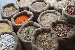 Beans, rice, lentils, oats, wheat, rye and barley in sack Stock Photos