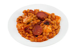 Beans with sauce, chorizo and chicken Stock Photo