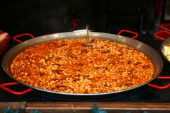 Beans and sausages cooked in a large cauldron. royalty free stock photography