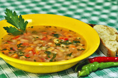 Beans soup with peppers and bread Stock Images
