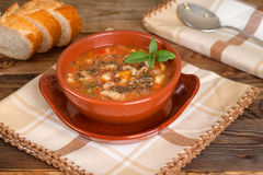 Beans soup served in crockery of clay. Horisontal shot Stock Photography