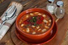 Beans soup served in crockery of clay Royalty Free Stock Photo