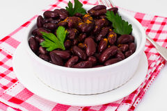 Beans, spices and curry in white salad bowl Stock Photo